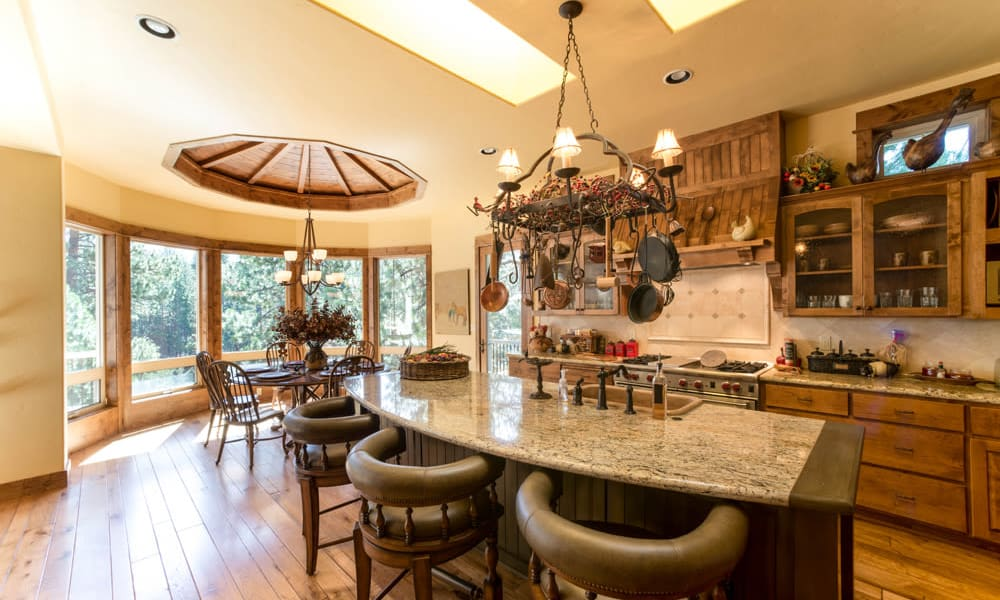 A cottage dining room and kitchen at Touchmark at Mount Bachelor Village in Bend, Oregon