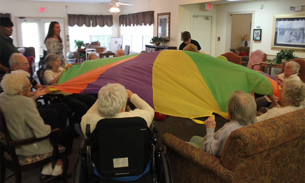 Residents playing with parachute at Heritage Green Assisted Living in Mechanicsville, Virginia