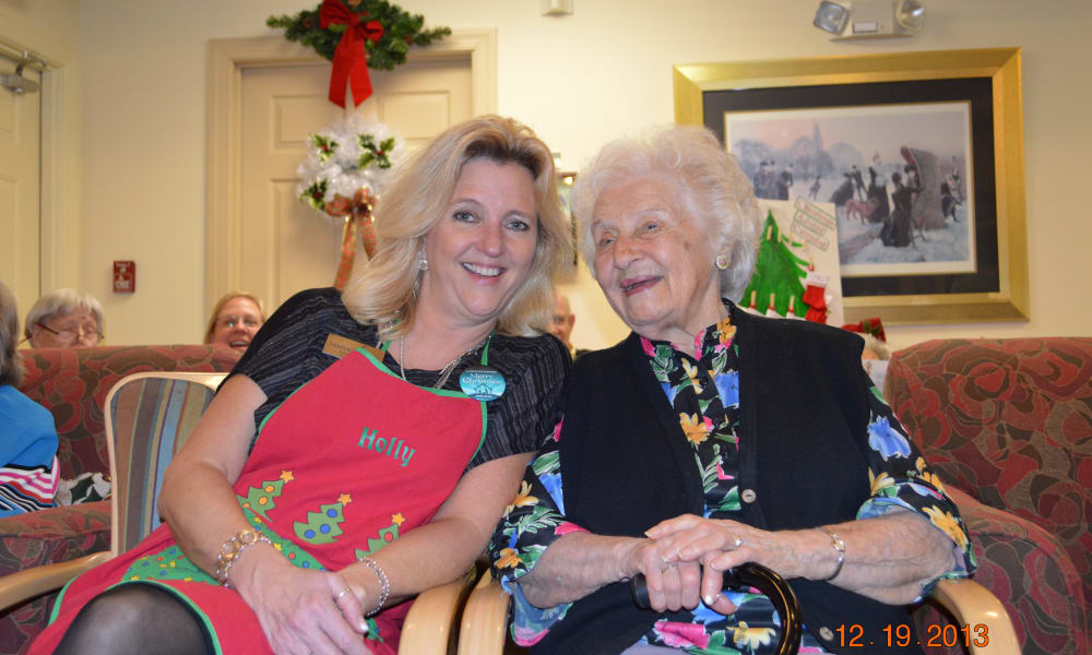 Resident and worker smiling at Heritage Green Assisted Living in Mechanicsville, Virginia