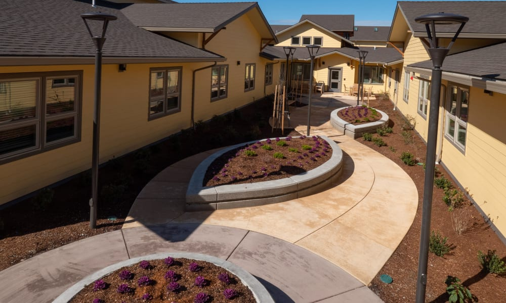 outside walking path at Pear Valley Senior Living in Central Point, Oregon