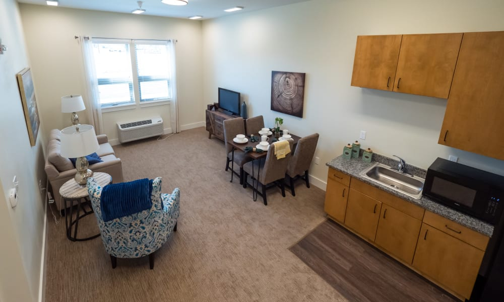 living room and kitchen at Pear Valley Senior Living in Central Point, Oregon
