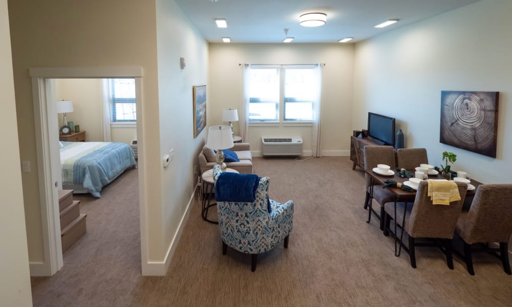 view of bedroom and living room at Pear Valley Senior Living in Central Point, Oregon