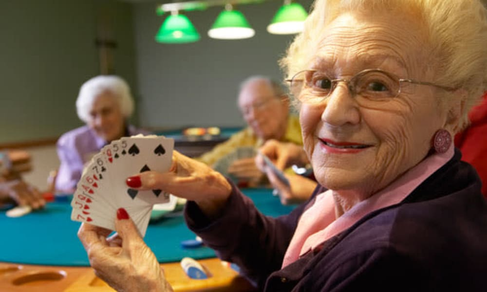 Resident playing cards at Belle Reve Senior Living in Milford, Pennsylvania