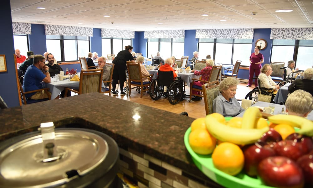 Fruit bowl and dining hall at Belle Reve Senior Living in Milford, Pennsylvania