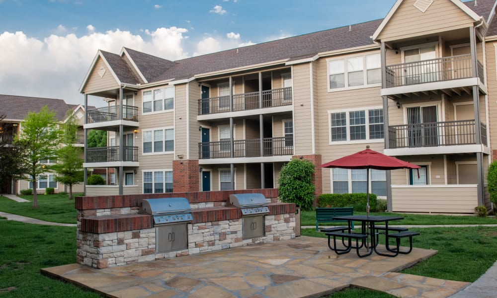 An outdoor patio area with grill at Winchester Apartments in Amarillo, Texas