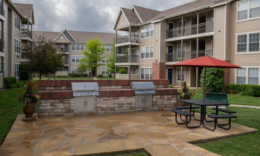 An outdoor patio with grills at Winchester Apartments in Amarillo, Texas
