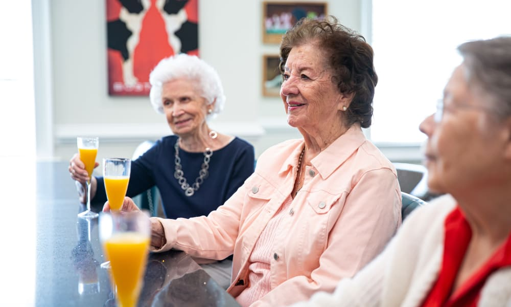 Residents talking over breakfast at The Mansions at Sandy Springs in Peachtree Corners, Georgia