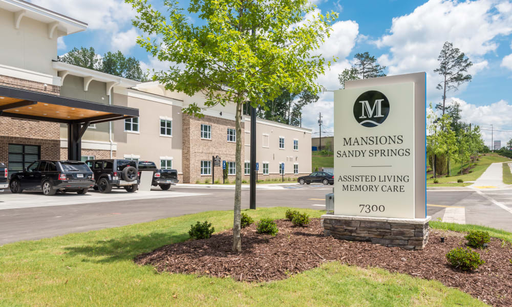 Drive up and signage for The Mansions at Sandy Springs Assisted Living and Memory Care in Peachtree Corners, Georgia