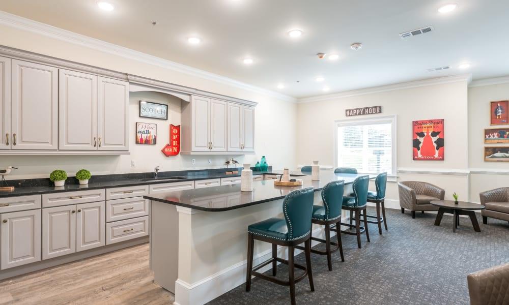 Open community kitchen with a bar at The Mansions at Sandy Springs in Peachtree Corners, Georgia