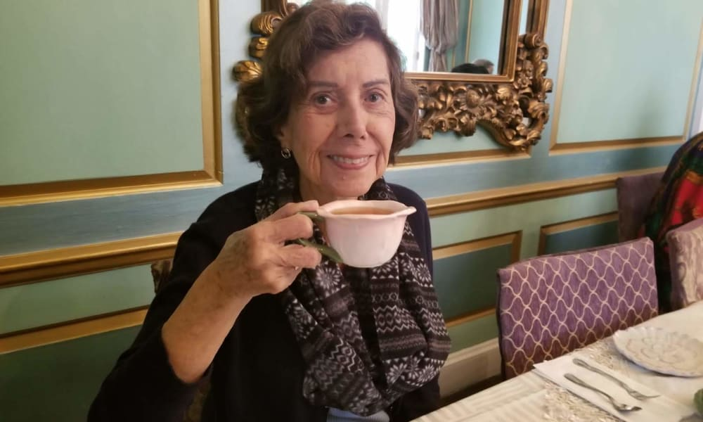 Smiling senior woman having tea at Regency Park Astoria
