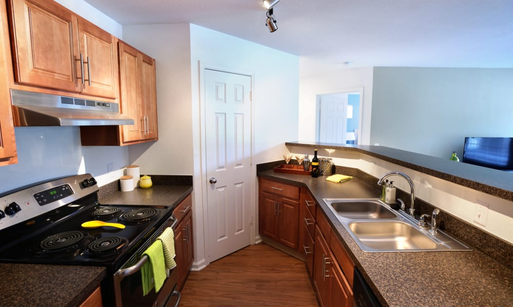 Kitchen and bar at Cascade Falls Apartments in Akron, Ohio
