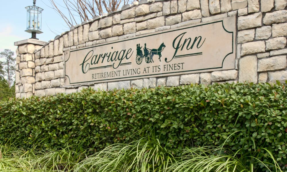 Signage at Carriage Inn Conroe in Conroe, Texas