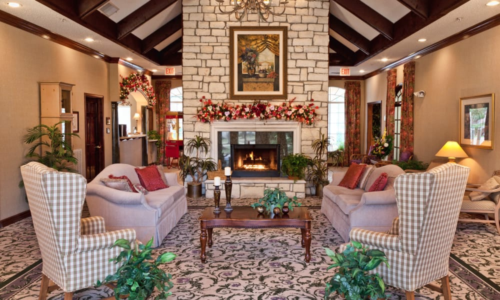 Main lobby with a fireplace and seating at Carriage Inn Conroe in Conroe, Texas