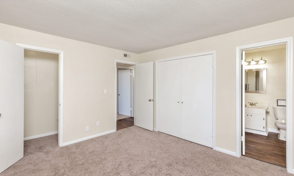 Spacious bedroom with carpet at Carriage Hills in Macon, Georgia