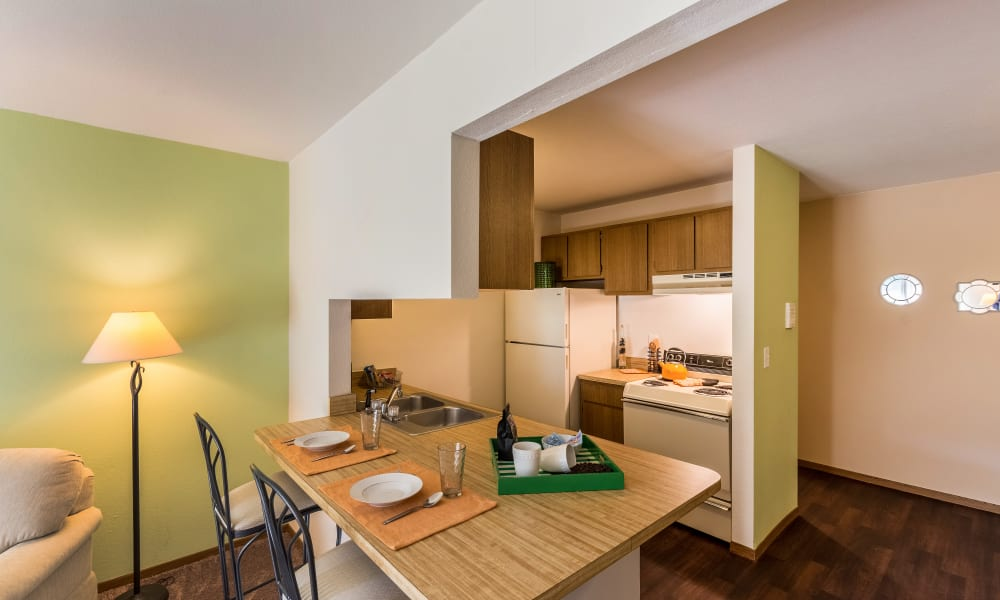 Kitchen and bar at Kellogg Cove Apartments in Kentwood, Michigan