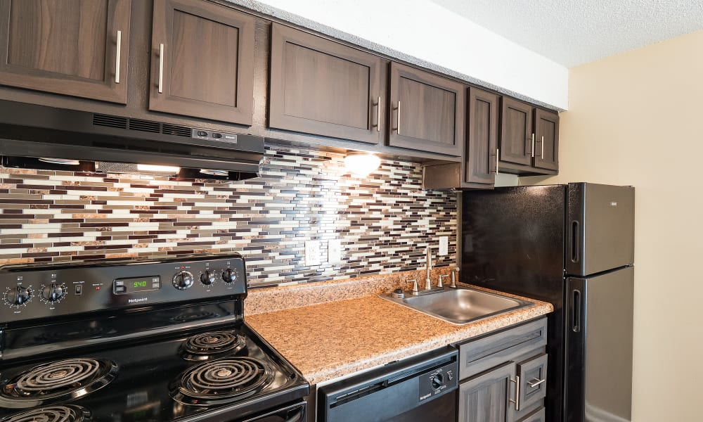 Kitchen with black appliances at The Hills at Oakwood in Chattanooga, Tennessee