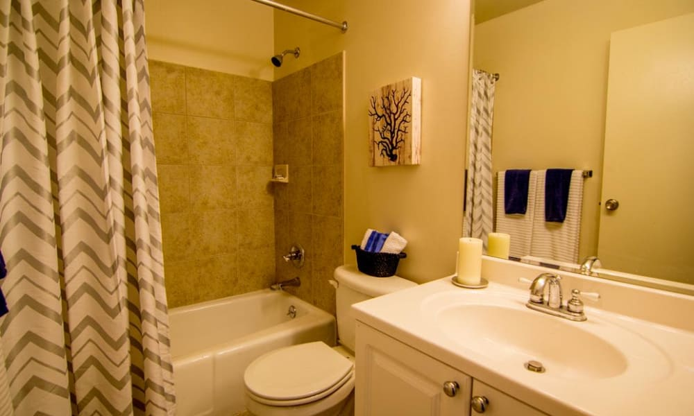 Bathrooms with storage space at Marchwood Apartment Homes in Exton, Pennsylvania.