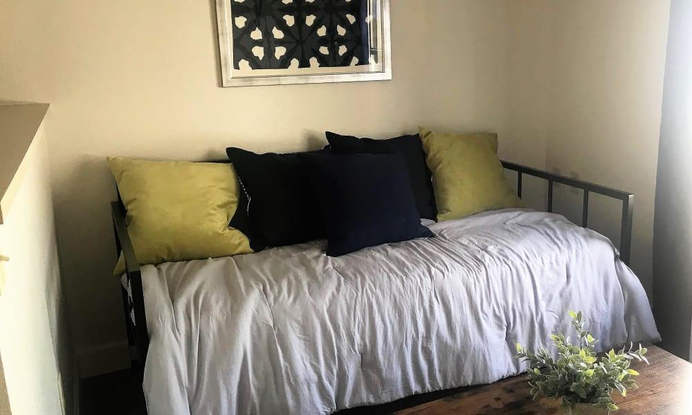 Cozy bedrooms at Courtyard Centre Apartments in Reno, Nevada.