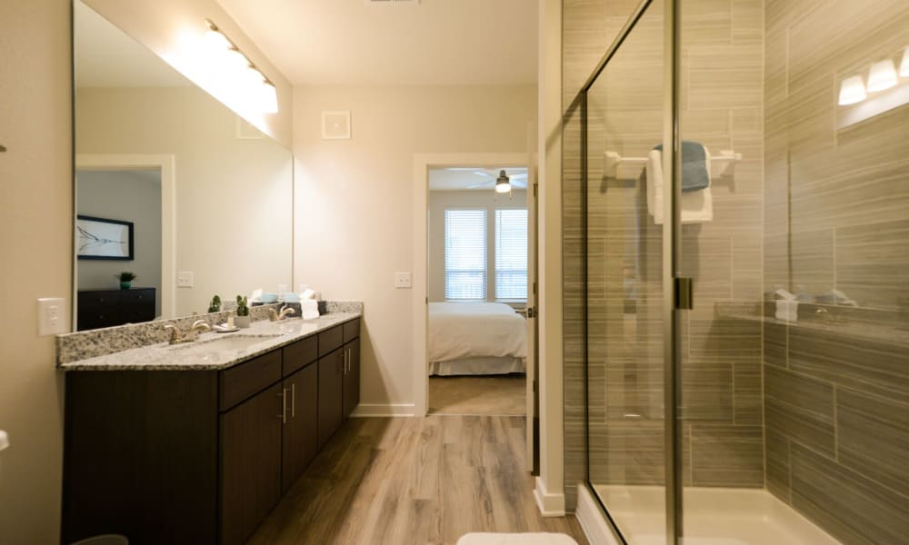 Bathroom with walk-in shower at Luxor Club in Jacksonville, Florida