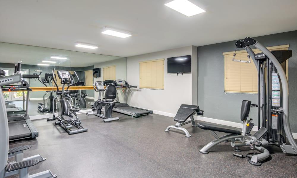 A spacious fitness center at Emerald Dunes Apartments in Miami Gardens, Florida