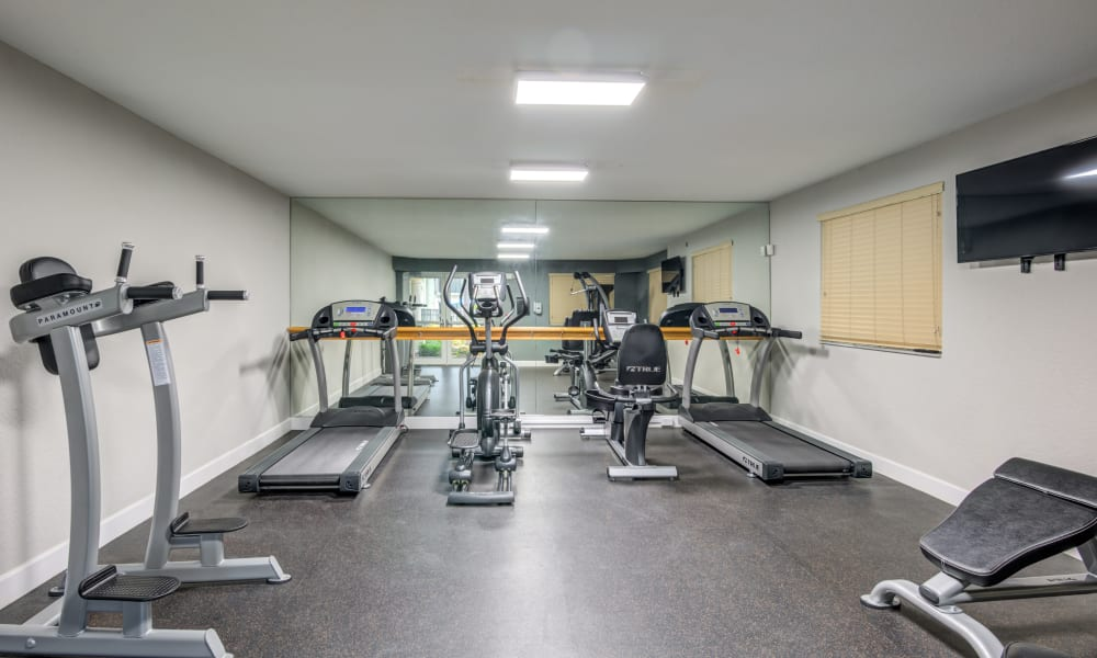 A fitness center with treadmills at Emerald Dunes Apartments in Miami Gardens, Florida