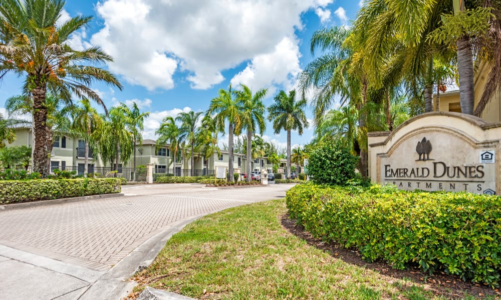 A beautifully manicured front entrance at Emerald Dunes Apartments in Miami Gardens, Florida