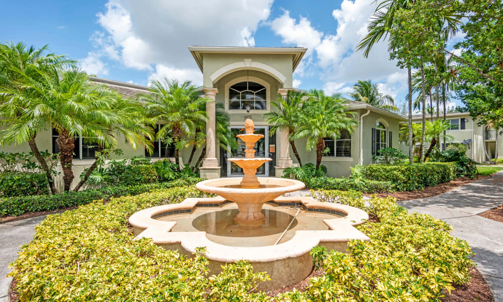 A beautiful front entrance fountain at Emerald Dunes Apartments in Miami Gardens, Florida