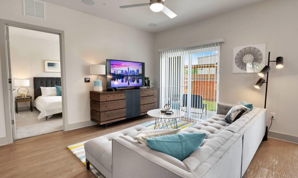 Enjoy the living room at Alta Tech Ridge in Austin, Texas