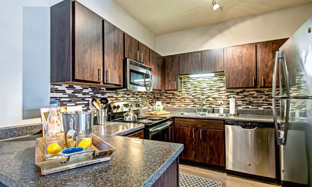 Kitchen with beautiful tile backsplash at The Flats @ 55 Twelve in Durham, North Carolina