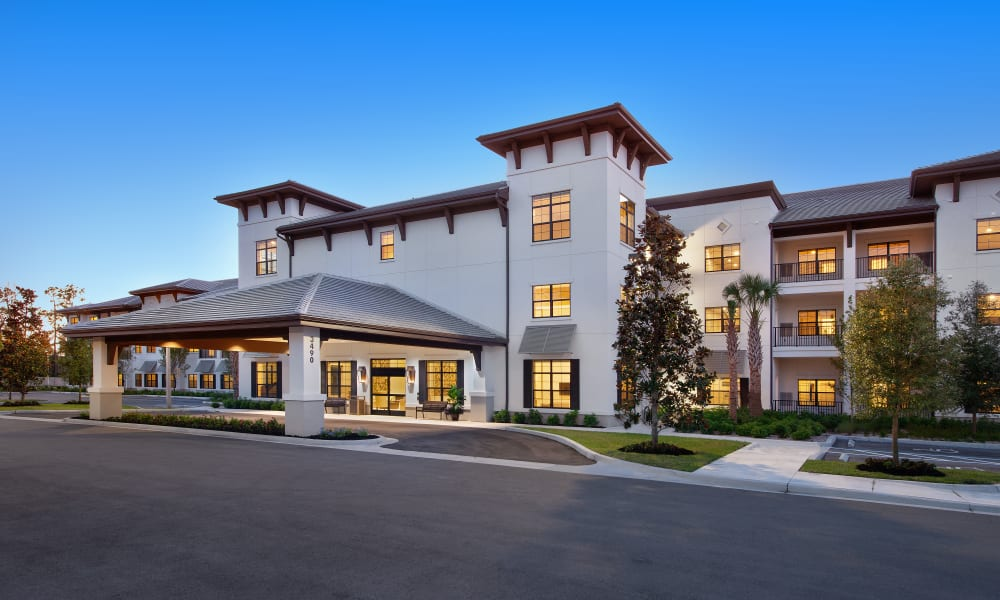 Exterior of Keystone Place at Four Mile Cove at dusk in Cape Coral, Florida