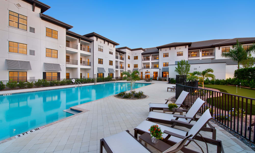 The outdoor swimming pool at Keystone Place at Four Mile Cove in Cape Coral, Florida