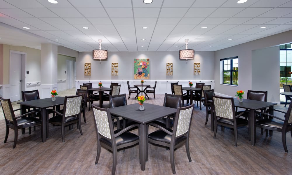 Large memory care dining room at Keystone Place at Naples Preserve in Naples, Florida