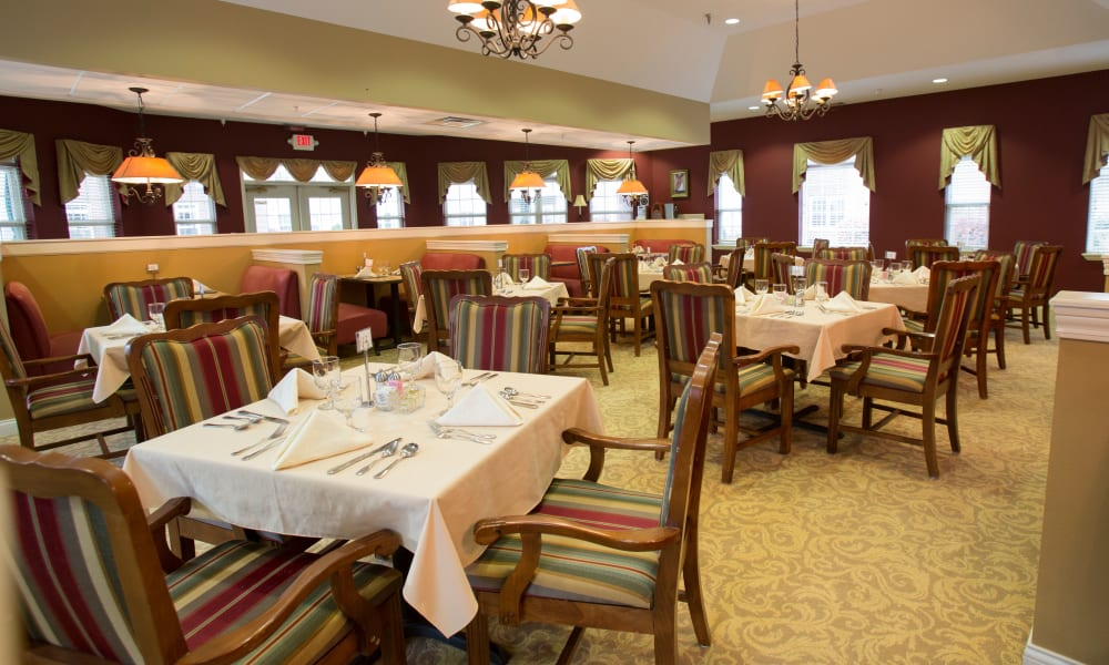 Dining room tables set for a meal at The Keystones of Cedar Rapids in Cedar Rapids, Iowa