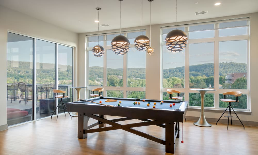 Enjoy the pool table at 50 Front Luxury Apartments in Binghamton, New York