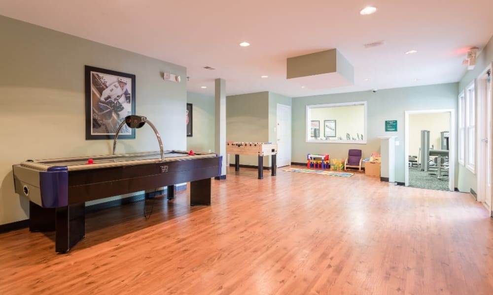 Clubhouse game room at Abbotts Run Apartments in Alexandria, Virginia.