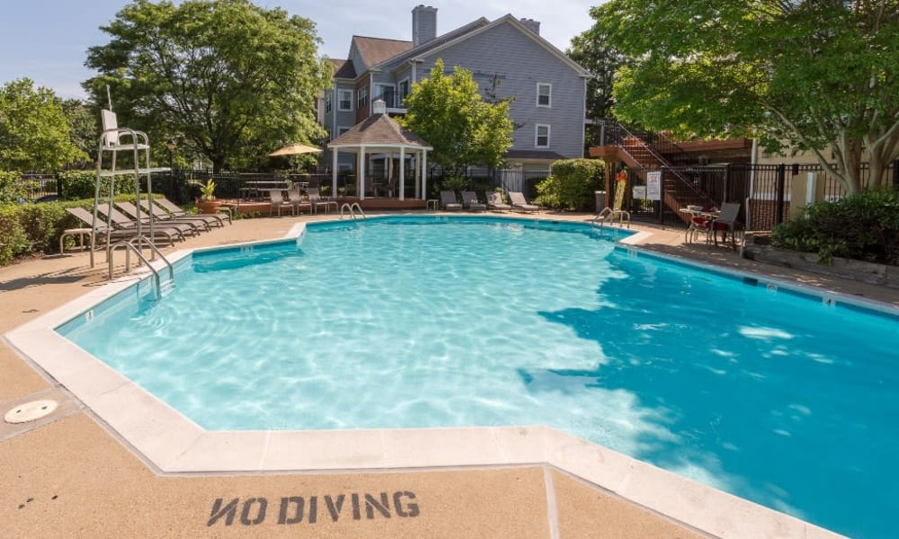 Pool with lounge chairs at Abbotts Run Apartments in Alexandria, Virginia.
