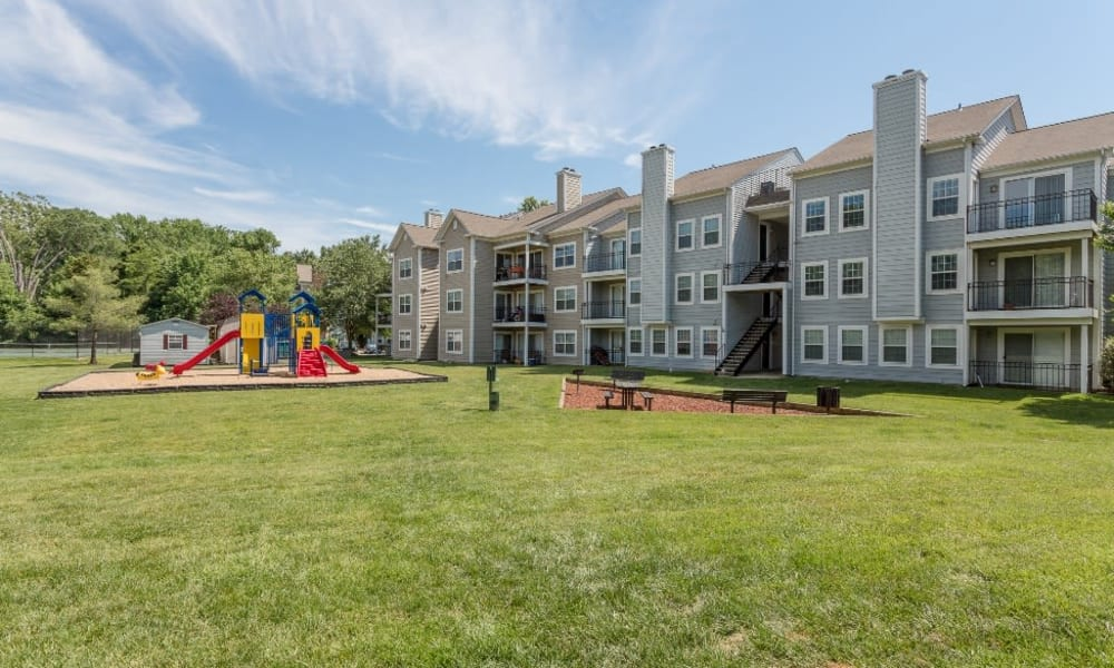 Apartment buildings and playground at Abbotts Run Apartments in Alexandria, Virginia.