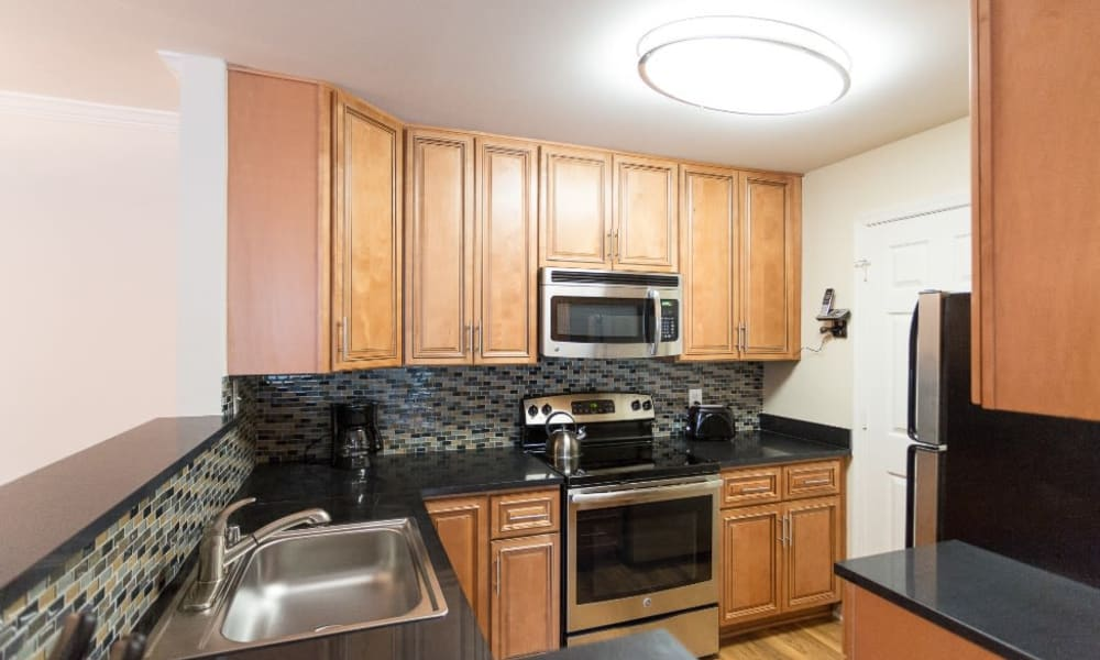 Kitchen with ample storage space at Abbotts Run Apartments in Alexandria, Virginia.