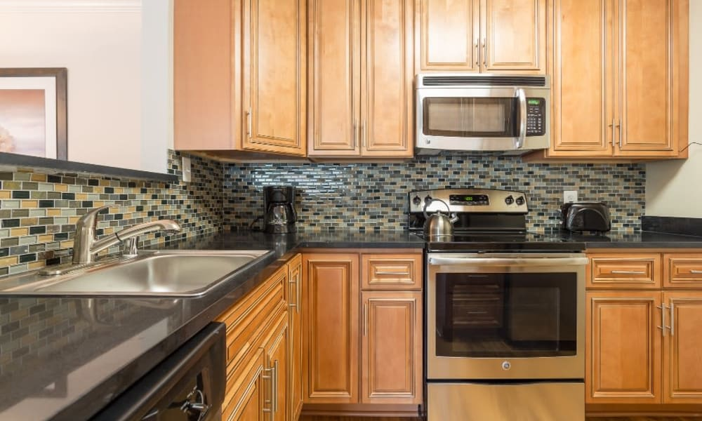 Kitchen with stainless-steel appliances at Abbotts Run Apartments in Alexandria, Virginia.