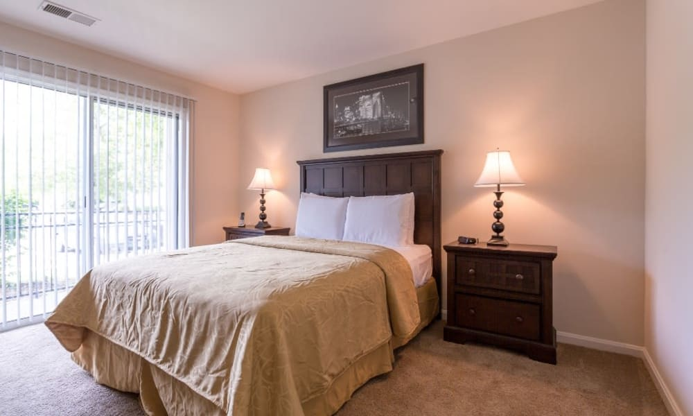 Bedroom with natural light at Abbotts Run in Alexandria, Virginia.