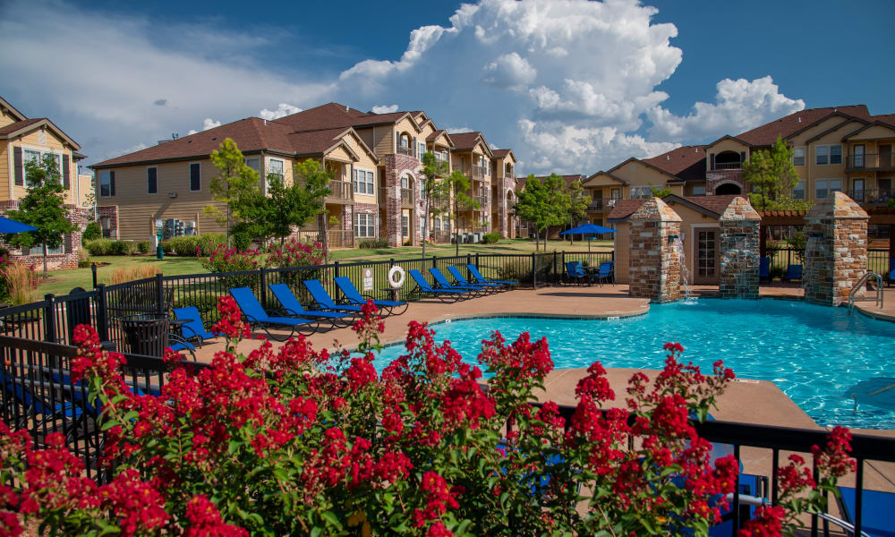 The pool with fence and landscaping at Villas at Canyon Ranch in Yukon, Oklahoma