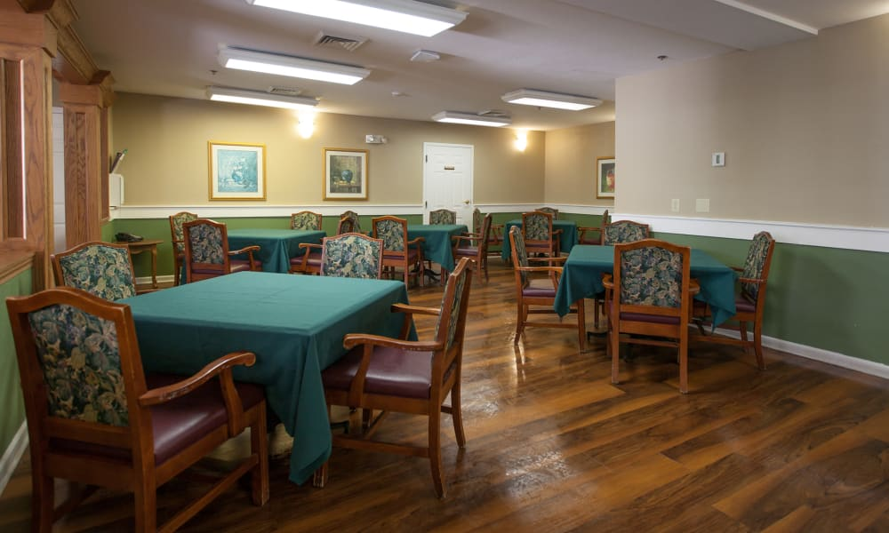 Dining hall with hardwood floors at Harbor Cove Memory Care in Hilton Head, South Carolina