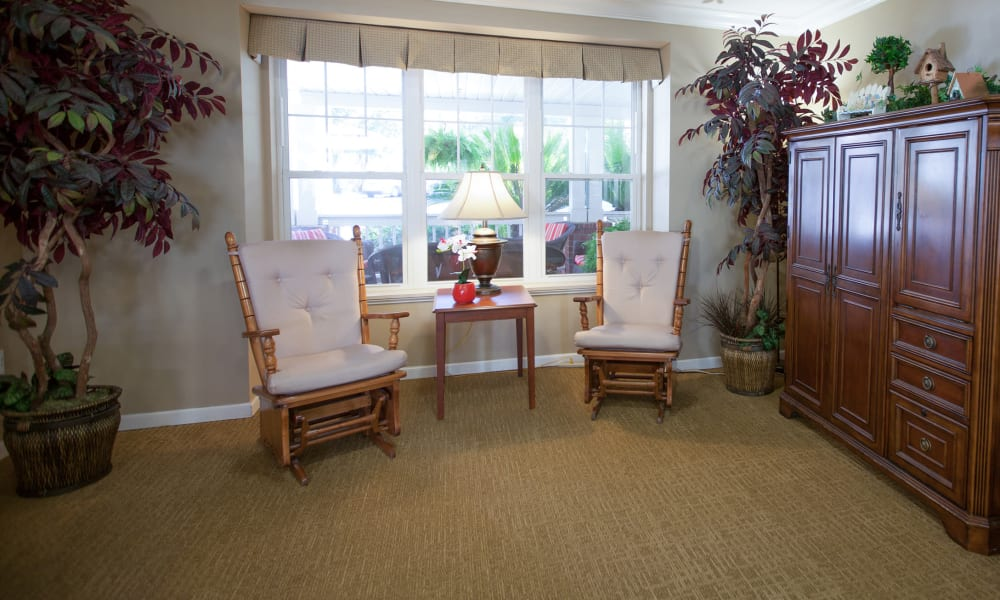 Two chairs in the library at Harbor Cove Memory Care in Hilton Head, South Carolina