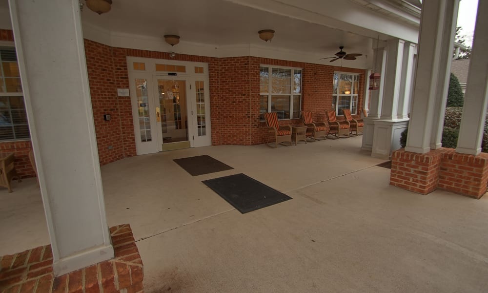Front porch with seating at Chandler Place Assisted Living & Memory Care in Rock Hill, South Carolina
