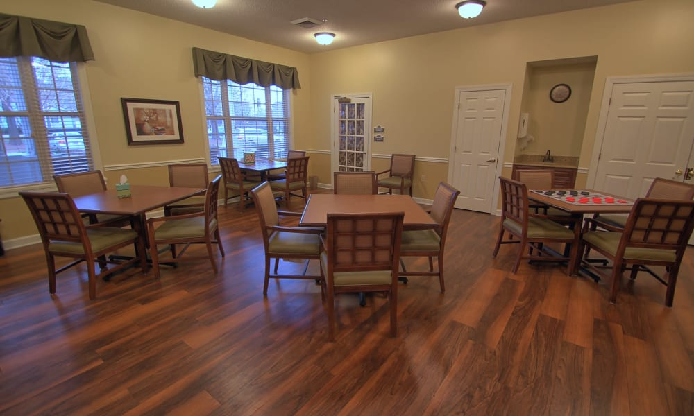 Tables set for four at Chandler Place Assisted Living & Memory Care in Rock Hill, South Carolina