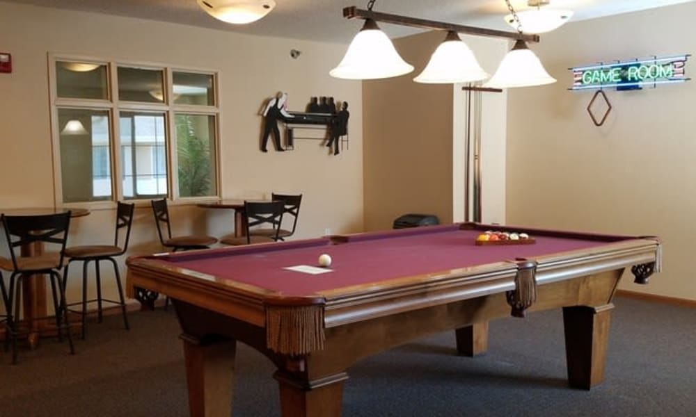 A billiards table with seating at Parkway Gardens Senior Apartment Community in Saint Paul, Minnesota