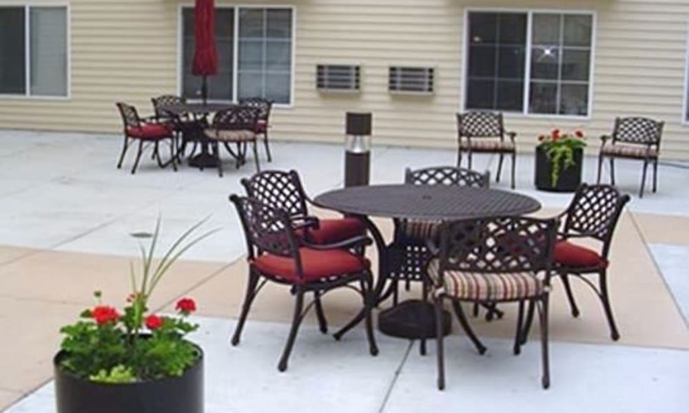 A patio with plenty of table and chairs at Parkway Gardens Senior Apartment Community in Saint Paul, Minnesota