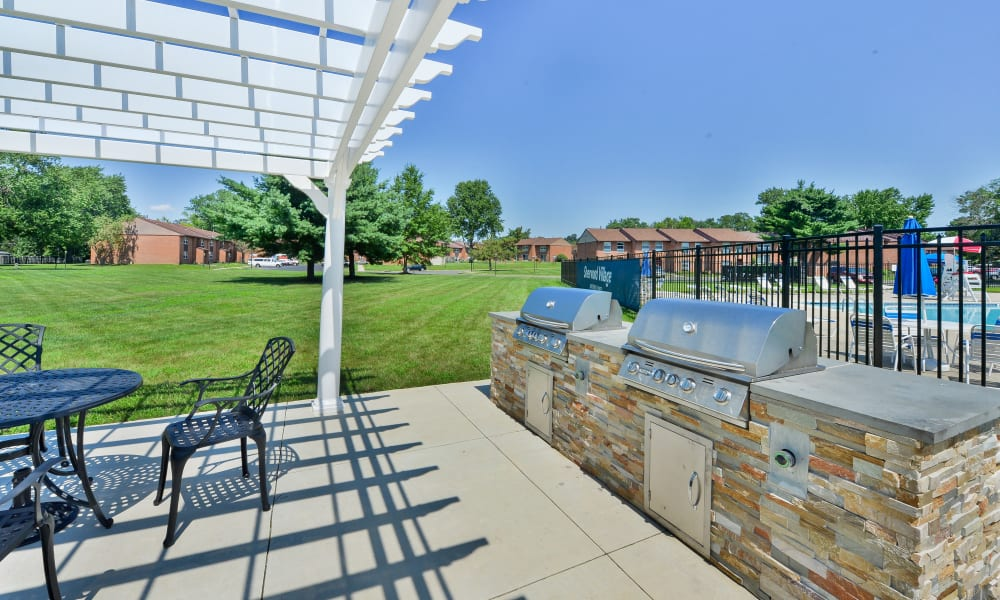 Enjoy Apartments with a BBQ Area at Sherwood Village Apartment & Townhomes
