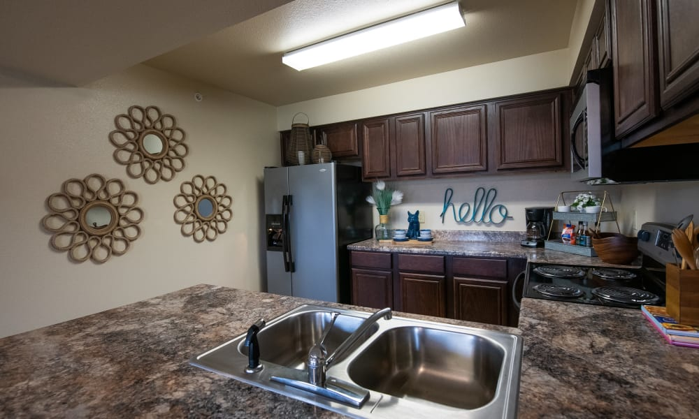 An apartment kitchen at Park at Mission Hills in Broken Arrow, Oklahoma