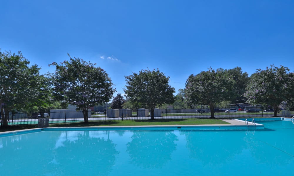 Spacious blue pool outside at Gwynn Oaks Landing Apartments & Townhomes, MD